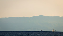 Sailing (Yannis Raf) Tags: blue sea seascape mountains canon boat sailing colours afternoon seagull minimal greece negativespace seafarer asgoodasitgets greeklandscape canoneos70d efs55250isii