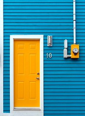 The Yellow Door (Karen_Chappell) Tags: door wood city blue urban white house canada yellow wooden paint downtown colours bright painted stjohns colourful clapboard eastcoast rowhouse jellybeanrow