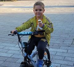 Macedonia- Every child likes ice-cream (ustung) Tags: street people nikon child outdoor citylife macedonia icecream byke skopje