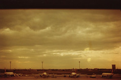Cloudy airport (josemanuelerre) Tags: trip travel viaje winter sky cloud cold film geometric plane turkey landscape golden fly airport cloudy kodak paisaje aeroplane line cielo frame land ready invierno s1 framing fro avin aeropuerto nube dorado viajar retina turqua atatrk analogic analgico volar listo lnea geometra nuboso aterrizar redscale