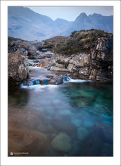 Fairy Pools (Maciej - landscape.lu) Tags: blue shadow mountain mountains color water colors rock stone digital season lens island photography gold golden march scotland waterfall spring rocks stream europe afternoon seasons isleofskye unitedkingdom outdoor falls dirt highland filter mineral late hazy pm viewpoint landforms springtime freshwater waterscape ecosse mountainrange vernalequinox filtre endofday glenbrittle ruisseau fairypools vernalseason singhray goldnbluepolarizer lookingawayfromcamera goldnblue sonydslra900 2470mmf28zassm coullins maciejbmarkiewicz wwwlandscapelu