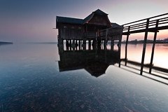 and another version of that boat house (tobiviereinseins) Tags: old blue light sunset orange sun lake cold color reflection nature water leaves yellow architecture contrast photoshop canon germany dark landscape bayern deutschland bavaria eos see leaf spring colorful europa europe exposure afternoon angle outdoor dusk hiking natur wide sigma wideangle gelb filter nd architektur colourful blau capture grad effect landschaft sonne kontrast ammersee wandern frhling gegenlicht lightroom langzeitbelichtung longtime 10mm cokin stegen lzb 450d lakeammer