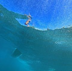 sliding overhead (bluewavechris) Tags: ocean blue sea sun water canon fun hawaii surf underwater action surfer wave maui swell 1022 seasea t1i
