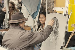 Portrait artist in action at Place du Tertre, Montmartre, Paris (Marco Boekestijn) Tags: life street city trip travel light portrait musician holiday paris france streets color colour art tourism shop seine square boat store spring nikon women europe artist gallery view place market drawing 5 postcard hill paintings visit montmartre tourist tourists days traveller boutique painter april marco guide greetings frankrijk garedunord beatiful parijs authentic attraction artworks 2012 metropole ladefence quartierlatin placedutertre travelphotography cityoflight cityoflove d80 welcometoparis boekestijn parisgeotagged