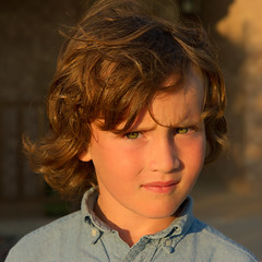 Golden Hour Portrait (SCHMEGGA) Tags: boy sunset portrait cute green pose hair aiden eyes texas child unitedstates serious curls stare northamerica locks goldenhour abilene buttondown ocbd