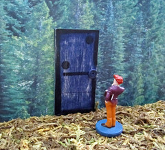 The Curious Man and the Seemingly Falling Doorway (Enchanticals ~I'm Coming Back) Tags: door wood blue orange man strange standing forest vintage wonder toy toys one glasses book woods purple handmade navy deep falling plastic odd round etsy oddity redhair curiosity hmm leaning clue plaything observing onedoor wavyhair thesecretlifeoftoys gamepiece flickraward enchanticals enchanticalsetsy gameofclue thecuriousman