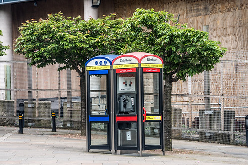 A telephone booth, telephone kiosk, telephone call box or telephone box is a small structure furnished with a payphone