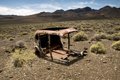 Gutted And Rusted (Curtis Gregory Perry) Tags: auto old lake abandoned car metal sedan rust automobile shot desert pyramid nevada rusty mobil holes rusted motor bullet forsaken gutted automvil xe automobil     samochd  kotse  otomobil   hi   bifrei  automobili   gluaisten