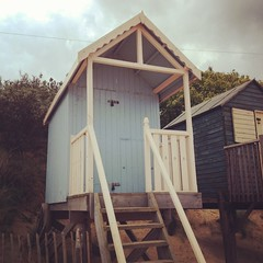 Another beach hut. (osh) Tags: wood bridge blue sunset sea summer england 6 sun shells fish beach rain weather birds sign yellow seashells port docks boats photography boat seaside fishing sand focus ship brother path stones wells hut pirate captain caution beachhut vans 4s siri pirateship bout hollister iphone wellsnextthesea summery ferryport vansoffthewall hollisterco waterbouy instagram iphone4s chiefscabin