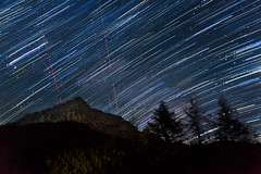 Cosmic dance (ChrisBrn) Tags: summer sky mountain forest stars airplanes silhouettes peak greece alpine nightsky spruce nigh startrails summersky airplanetrails