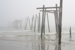 The Pier on The Peninsula (Lizzography) Tags: ocean wood beach water fog pier newjersey log sand waves cloudy ripples oceancity dilapidated cantsee march2012