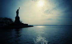 Approaching Liberty (Dan Haug) Tags: statueofliberty xf14mmf28r xt1 newyorkcity water skyline historic silhouette sun liberty shimmering reflections explore explored getty gettyimages