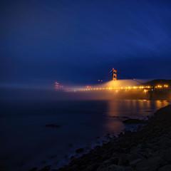 Golden Gate from Point Cavallo (kevinwenning) Tags: sanfrancisco bridge motion fog lights coast rocks glow unitedstates goldengatebridge shore sanfranciscobay marinheadlands limepoint wenning pointcavallo carlthefog kevinwenning intentionallylostcom