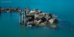 Poles Apart (Normann Photography) Tags: longexposure sea green rural suburban outdoor decay crab pole shore daytime marinelife waterscape ndfilter polesapart leefilters shallowwaters thebigstopper