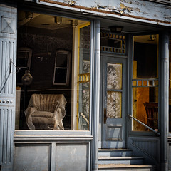 The Shop (Geoffrey Coelho Photography) Tags: street old city urban reflection abandoned window shop architecture square store chair closed peeling paint exterior furniture massachusetts gritty architectural haunted sidewalk storefront berkshires haunting streetscape northadams massaxhusetts berkshitecounty