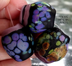 Rocks African Violets (Laura Blanck Openstudio) Tags: show etched usa abstract art glass festival set beads big italian rocks colorful published artist glow purple handmade stones fine arts violet lavender plum funky jewelry pebbles made odd lilac earthy faceted winner mauve opaque bead organic nuggets murano grape lampwork multicolor raku artisan matte whimsical loose frosted frit openstudio asymmetric speckles openstudiobeads