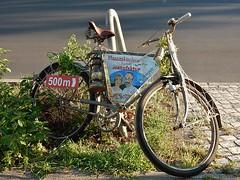 Bicycle Signpost (mikecogh) Tags: berlin bicycle advertising weeds permanent wannsee kerosenelamp