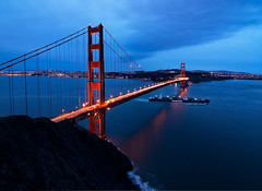 Ship in the Night... and Golden Gate Bridge (danielpivnick) Tags: sanfrancisco california bridge storm water night clouds evening bay boat ship darkness pacific marin goldengatebridge goldengate baybridge bayarea headlands ggbridge lighttrails containership viewpoint marinheadlands sutrotower portofoakland hapaglloyd internationalorange nikond90