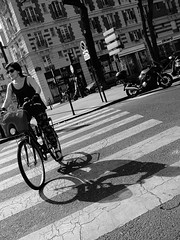 Cycling on pedestrian crossing (vieweronline) Tags: street people blackandwhite bw paris france monochrome bike crossing noiretblanc streetphotography pedestrian nb tilt streetscenes zebracrossing g12 cameratilt canong12
