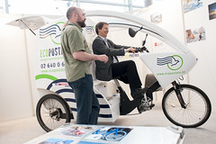 A delegate tries out an ecopostale bicycle