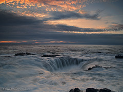 That big hole in the sea (Dave Arnold Photo) Tags: ocean sunset sea usa beach oregon coast us photo pacific northwest image or arnold dramatic wave pic photograph pacificnorthwest spoutinghorn thor centralcoast drama ore yachats hightide pictur capeperpetua lincolncounty davearnold centraloregoncoast darnold davearnoldphotocom thorswell