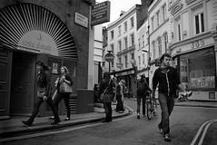 Hanway St - Jubilee preparation (stugee) Tags: street people urban bw costa white black london monochrome tarmac st bar canon jack eos mono noir decay jubilee flag soho union north spanish bradleys figures jbs dorada hanway 60d