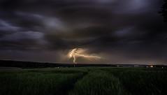 Gewitter II - when a thunderstorm starts dancing (Florian Grundstein) Tags: storm clouds nacht flash wolken thunderstorm lightning blitz gewitter langzeitbelichtung sturm unwetter supercell superzelle