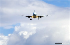 Coming Home (Clayton Perry Photoworks) Tags: sky clouds airplane airport yvr
