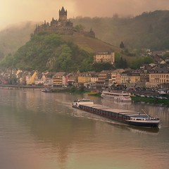 Mosel River and the Castle of Cochem (Bn) Tags: sun sunlight mist castle history rain fog fairytale river germany point geotagged deutschland spring high topf50 day ray view magic ships dream battle charm cargo vineyards valley alemania knight layers schloss viewpoint topf100 defense cochem topf200 freight impressive steep mosel rheinlandpfalz moselle reichsburg moezel 100faves 50faves 200faves 1000ad vrachtboot reichburg rijksburcht geo:lon=7168059 geo:lat=50147382