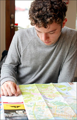 Tourist with Map (Ben Andreas Harding) Tags: man male tourism person iceland adult map maps stock plan tourist planning focused youngman overview stockphoto 35mm18g