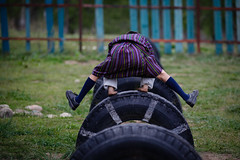 Leapfrog (Lil [Kristen Elsby]) Tags: travel school boy game playground fun kid jump uniform asia child bhutan leapfrog stripes topv1111 tire frombehind gho leap striped tyre schooluniform schoolboy bumthang travelphotography jakar canon70200f28l canon7020028l canon5dmarkii