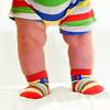 Q Feet (Khaled A.K) Tags: baby feet colors socks square photography nikon infant child saudi arabia format shorts sa jeddah khaled ksa qaswara kashgari kashkari
