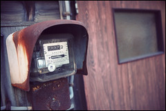 Electric meter (Eric Flexyourhead) Tags: old city urban brown house detail electric japan wall tokyo wooden bokeh rusty   toshiba meter  setagaya patina fragment electricmeter  setagayaku higashikitazawa olympusep1 panasoniclumix20mmf17