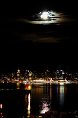 Moon over Vancouver's skyline (Peggy2012CREATIVELENZ) Tags: ocean blue red sky moon white canada green yellow vancouver clouds reflections lights bc nightshot burrardinlet canadaplace tanker vancouverskyline blinkagain img8074a peggy2012creativelenz
