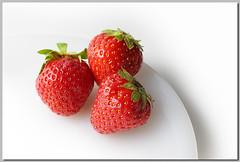 3 Erdbeeren | 3 Strawberries [explored] (Sebastian.Schneider) Tags: food macro closeup fruit studio spring strawberry indoor explore highkey makro frucht tabletop nahaufnahme teller erdbeere obst frhjahr explored entdecken