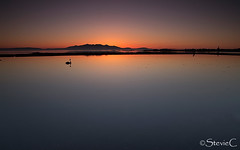Swan Lake (StevieC - Photography) Tags: sunset orange beach nature scotland calm swanlake tranquil steviec