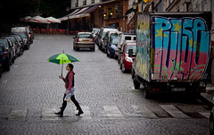 Walking in the Rain - Abbesses, Montmartre - Paris, France (ChrisGoldNY) Tags: city travel girls people urban paris france green rain walking french graffiti women europa europe european forsale eu montmartre cobblestone viajes posters trucks crosswalk umbrellas raining vacations bookcovers albumcovers abbesses gridskipper unanimous jaunted thechallengefactory ultimategrind chrisgoldny chrisgold chrisgoldphoto