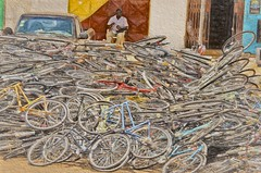 Where have all the bicycles gone? (Pejasar) Tags: bikes bicycles pile stack transportation bikepile store accra ghana westafrica africa art paintcreations