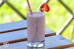 Strawberry cocktail in the garden (WDnet) Tags: wood red food white green glass fruit milk healthy strawberry berry colorful natural drink sweet drinking shell straw strawberries lifestyle calcium fresh health meal blended yoghurt organic diet dairy yogurt smoothie kefir nutrition d3100