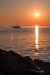 Vicini... ma irraggiungibili. (ambrasimonetti) Tags: sea sunshine sunrise boat barca mare peace alba explore shade sole sanbenedettodeltronto rayofsun explored09052016