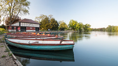Valentines Lake Boat 1 (ParmarC) Tags: park uk longexposure sunset lake detail reflection london nature water canon landscape eos boat d70 perspective circular polariser