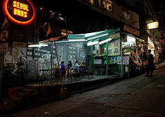 """100 yr old dai pai dong and 1 yr old fusion restaurant"" (hugo poon - one day in my life) Tags: sign hongkong lights colours eating soho central fusion vanishing x70 citynight elginstreet daipaidong  seoulbros"