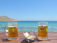 Life's a beach (pefkosmad) Tags: sea summer vacation sky holiday hot beach beer glass weather june bar island drink horizon hellas greece greekislands griechenland daytrip mythos halki 2016 dodecanese