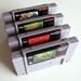 Four SNES cartridges