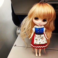 How to freak out your seat mates: weird doll in a wig.