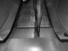 Laddegs (▓UTHΔN▓ (Kemar Reid)) Tags: street camera bw white black station digital fuji legs escalator tights oxford heels zip uthan av200 ladderd