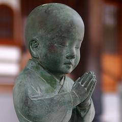 Pray (photoholic image) Tags: sculpture statue temple child voigtlander pray praying buddhism stonestatue childpriest nokton25mmf095 olympuspenep3 voigtalandernokton25mmf095