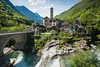 Lavertezzo (Thierry Hennet) Tags: bridge blue cloud sunlight alps tree green church architecture zeiss river switzerland tessin spring ticino aqua village suisse sony granite oldtown traveldestinations verzasca a900 lavertezzo cz1635mmf28