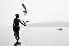 Maiden with the seagull B&W (Tomislav Bicanic) Tags: sea statue seagull croatia lungomare maiden opatija madonnadelmare maidenwiththeseagull