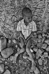Himba Boy (alisdair jones) Tags: africa boy wall rocks tribe namibia himba ef35mmf14lusm